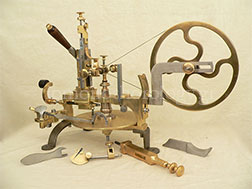 Restoration or reconstruction of Swiss wheel cutting engine with its accessories
